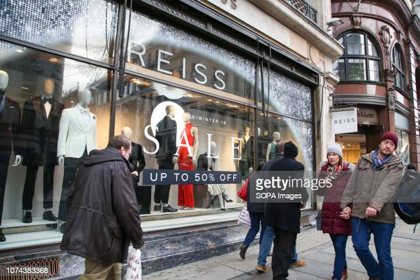 Shoppers are seen walking by a store on Londons Oxford Street with 6 days to Christmas Day Retailers are expecting a rush of shoppers in the leadup...