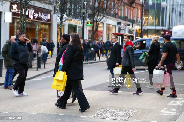 Shoppers are seen with selfridges shopping bags on Londons Oxford Street with 3 days to Christmas Day Retailers are expecting a rush of shoppers in...