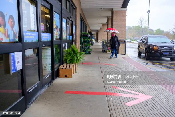 Shoppers arrive at a Kroger supermarket to find out why it closed early at 4 p.m. On Easter. The market, which was once open 24 hours, 7 days per...