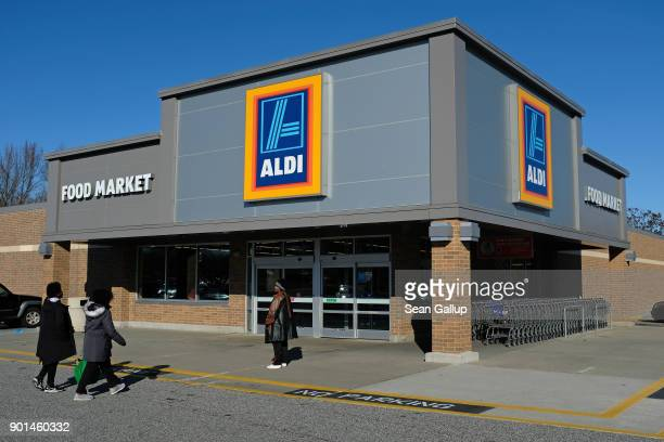 Shoppers arrive at an Aldi discount grocery store on December 28 2017 in Edgewood Maryland Aldi which has approximtely 1700 stores across the USA...