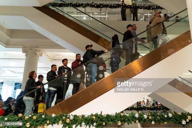 Shoppers arrive in search of bargains in Selfridges department store during the Boxing Day sale in central London on December 26 2019 With...