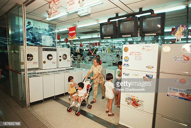 Shoppers as the entrance of the Sogo department store in central Singapore