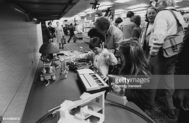 Shoppers at a branch of the British Home Stores department store chain on the ground floor of the former Derry Toms building on Kensington High...
