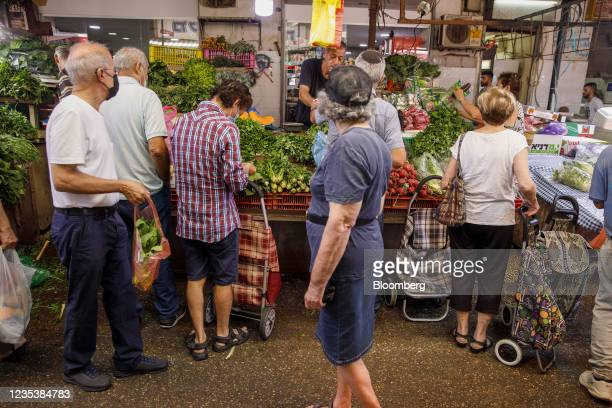 Shoppers at a fresh produce stall in Carmel Market in Tel Aviv, Israel, on Monday, Sept. 20, 2021. A third dose of thePfizer Inc.-BioNTech SECovid...