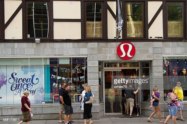 shoppers at a lululemon athletic store - lululemon stock pictures, royalty-free photos & images