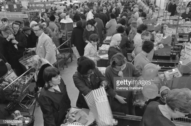 Shoppers at a Tesco supermarket in Brixton, south London, UK, 1966.
