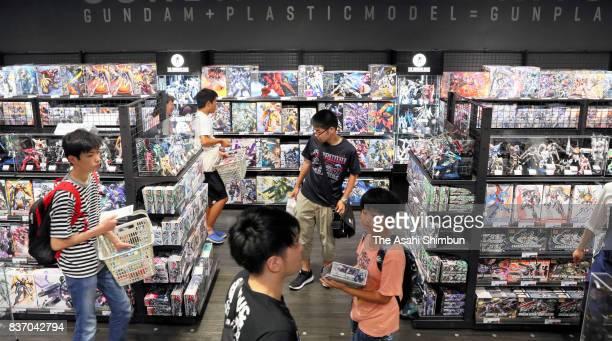 Shoppers at Gundam Base Tokyo check at Gundam Base Tokyo on August 19 2017 in Tokyo Japan Gundam mania swooped into the capital on Aug 19 with a long...