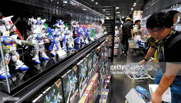 Shoppers at Gundam Base Tokyo fill their carts with plastic models at Gundam Base Tokyo on August 19 2017 in Tokyo Japan Gundam mania swooped into...