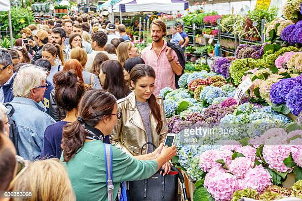 Shoppers at London street market