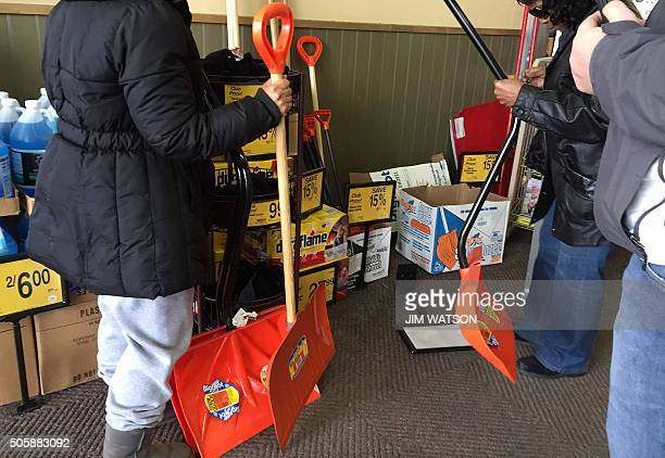 Shoppers at Safeway in Bowie Maryland grab what is left of the snow shovels on January 20 as weather forecasters predict an incoming snow blizzard to...