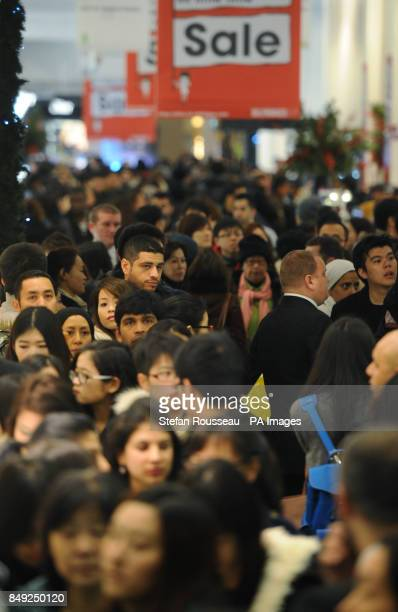 Shoppers at Selfridges department store in London's Oxford Street on the first day of their winter sale where they took Acircpound15 million in the...