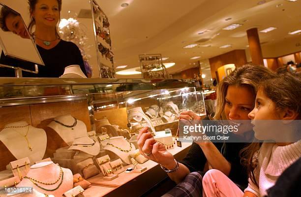 DENVER CO NOVEMBER 29 2003 Shoppers at the Cherry Creek Mall in Denver Molly<cq> Monblatt<cq> shows her daughter Ellie<cq> 4 right a Gurhan<cq>24k...