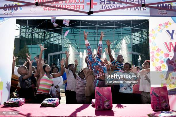 Shoppers attend a promotion for a detergent brand on May 1 2013 at Maponya shopping Mall Soweto South Africa Maponya is one of several new shopping...