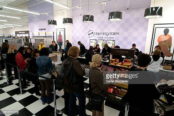 Shoppers attend the Bloomingdale's The Outlet Opening at Woodfield on November 3 2011 in Schaumburg Illinois