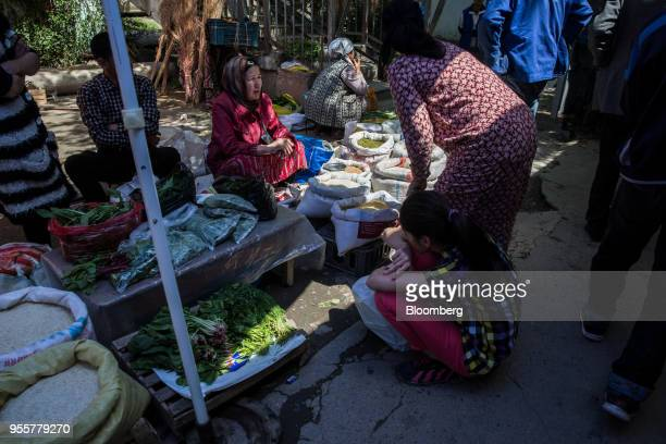 Shoppers browse a vegetable stall at a market in Dushanbe Tajikistan on Sunday April 22 2018 Flung into independence after the Soviet Union collapsed...