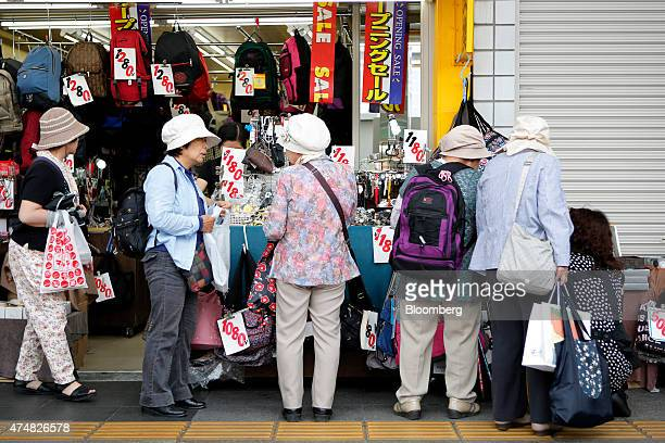 Shoppers browse at a store in the Sugamo district of Tokyo Japan on Sunday May 24 2015 Japan's Topix index fell for the first time in nine days...