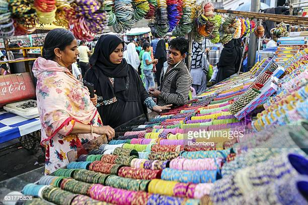 Shoppers browse bangles at a market stall in Ahmedabad Gujarat India on Wednesday Jan 11 2017 Hailed as one of biggest reforms in generations the...