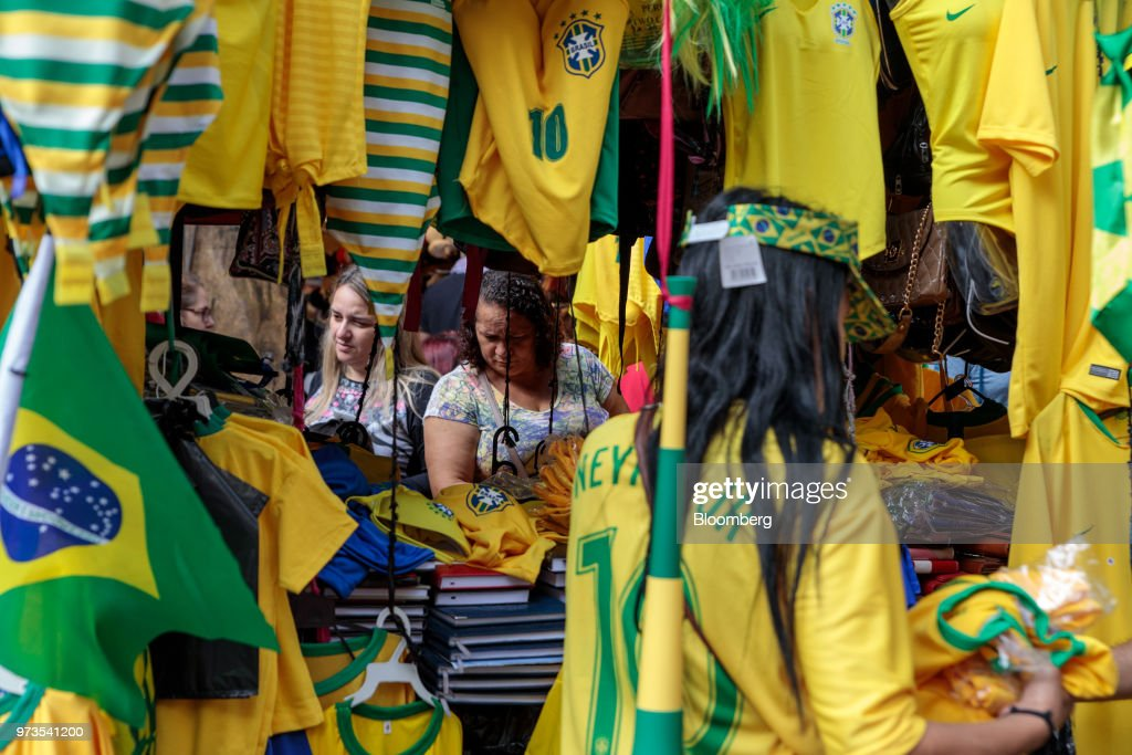 Shoppers browse Brazilian themed merchandise ahead of the FIFA World Cup games in downtown Sao Paulo, Brazil, on Wednesday, June 13, 2018. In a curious quirk of Brazil's electoral calendar, for the last 28 years Latin America's largest economy has gone to the polls shortly after the World Cup. In the football-obsessed country, politicians have long attempted to hijack the sport to burnish their image. Photographer: Patricia Monteiro/Bloomberg via Getty Images