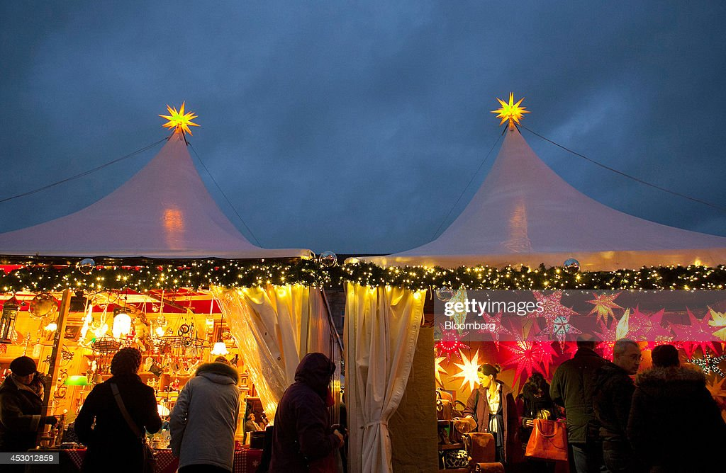 Shoppers browse decorated stalls at a market ahead of Christmas in Berlin, Germany, on Sunday, Dec. 1, 2013. Euro-area economic growth slowed to 0.1 percent in the third quarter after a 0.3 percent gain in the previous three months. Photographer: Krisztian Bocsi/Bloomberg via Getty Images