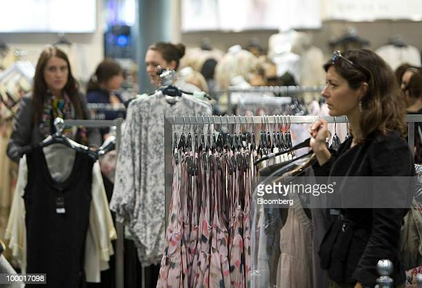 Shoppers browse for clothing at a Topshop retail store in London UK on Thursday May 20 2010 Sir Philip Green the billionaire owner of Arcadia Group...