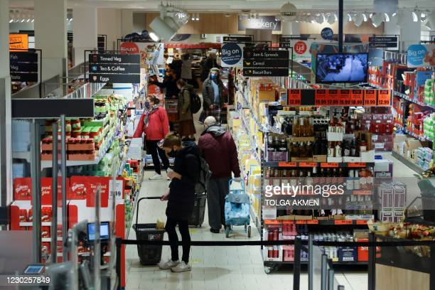 Shoppers browse for goods inside an Lidl supermarket in Walthamstow in north east London on December 22, 2020. - The British government said Tuesday...