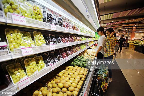 Shoppers browse fruit at the Aeon Co mall in the Long Bien district of Hanoi Vietnam on Thursday July 21 2016 With a young population an expanding...