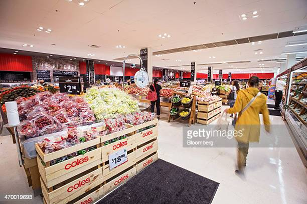 Shoppers browse in the produce section of a Coles supermarket operated by Wesfarmers Ltd in Sydney Australia on Tuesday Feb 18 2014 Wesfarmers...