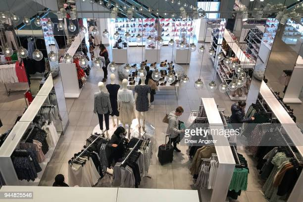 Shoppers browse items at an HM store in the Herald Square neighborhood of Manhattan April 11 2018 in New York City US consumer prices rose 24 percent...