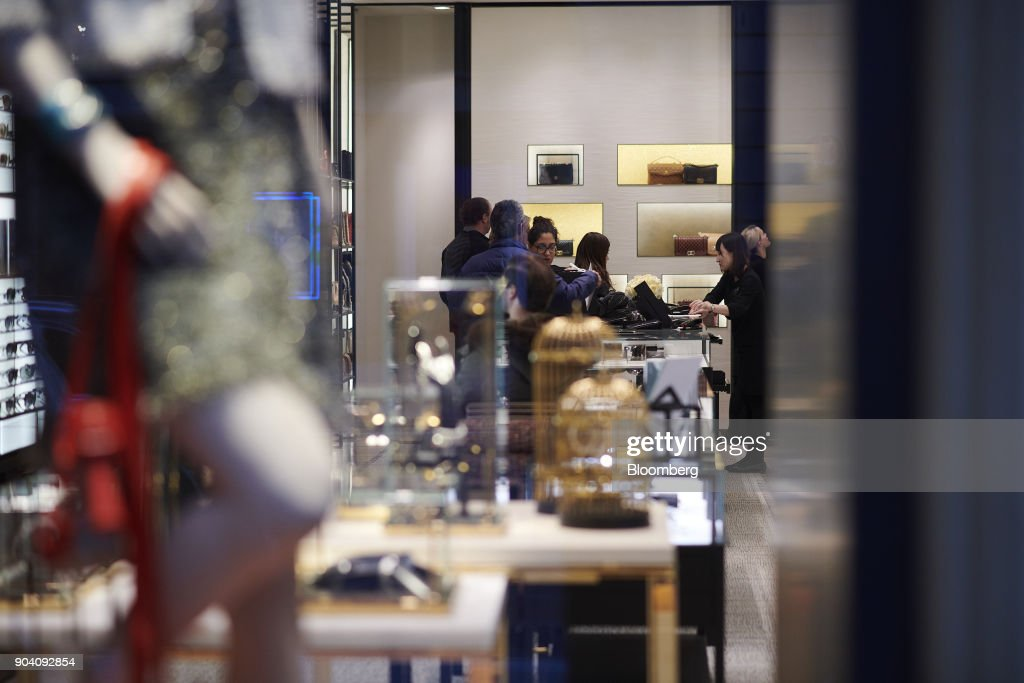 Shoppers browse luxury items inside a Chanel SA store in Munich, Germany, on Tuesday, Jan. 9, 2018. The German economy's solid 2017 performance extended into the final three months of the year, with growth of about half a percent. Photographer: Dominik Osswald/Bloomberg via Getty Images