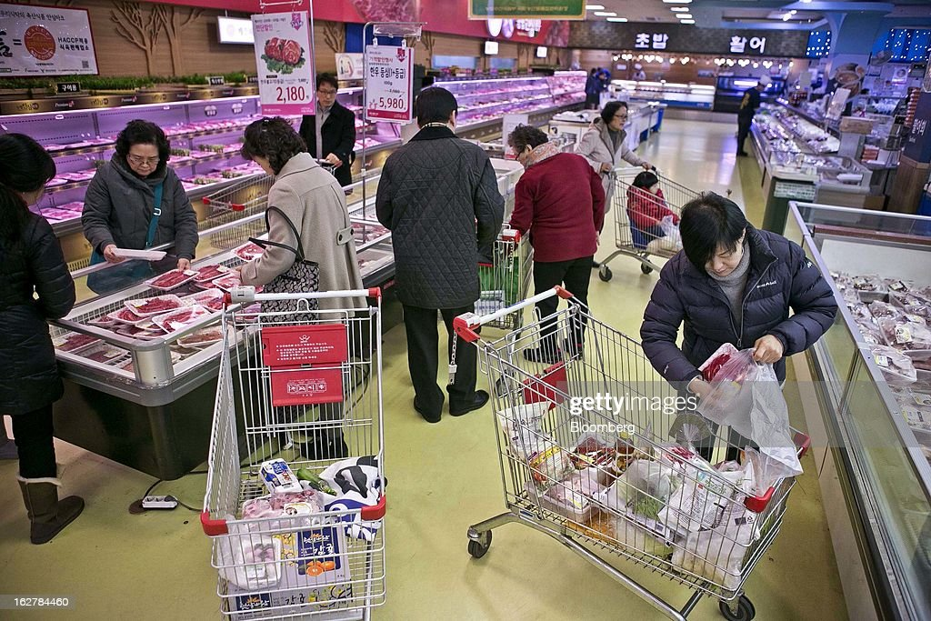 Shoppers browse meat at Hanaro Mart in Seoul, South Korea, on Tuesday, Feb. 26, 2013. South Korean consumer confidence remained at its highest level since May as gains in the won drove down the prices of imported goods. Photographer: Jean Chung/Bloomberg via Getty Images