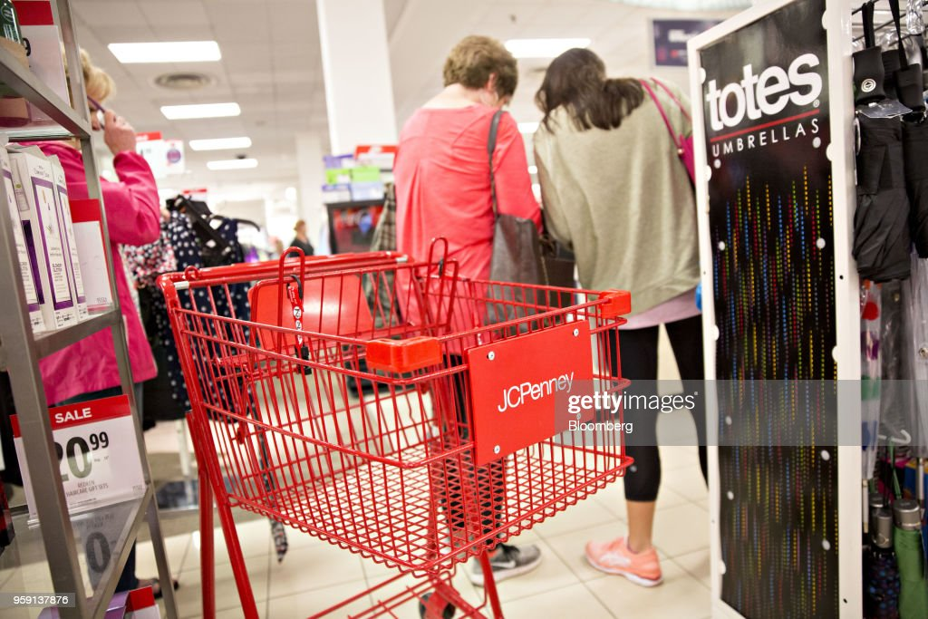 Shoppers browse merchandise inside a J.C. Penney Co. store in Peoria, Illinois, U.S., on Saturday, May 12, 2018. J.C. Penney Co. is scheduled to release earnings figures on May 17. Photographer: Daniel Acker/Bloomberg via Getty Images