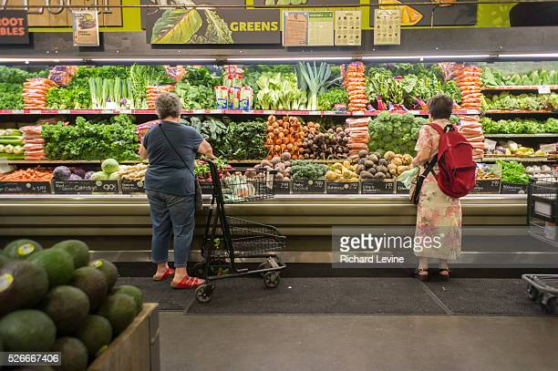 Shoppers browse produce at the Whole Foods Market in the East Village in New York on Saturday May 30 2015 Whole Foods is to report its fiscal...