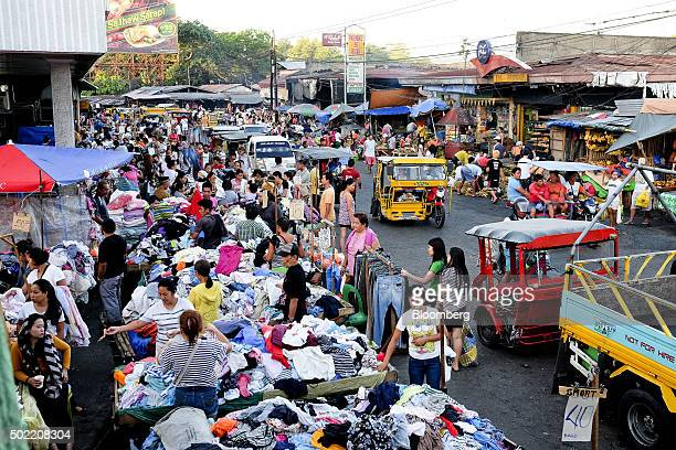 Shoppers browse stalls at a market in Davao Mindanao the Philippines on Saturday Dec 12 2015 Davao city's reputation as one of the safest most...