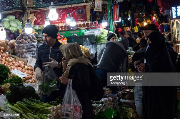 Shoppers browse stores selling food electronics clothing and jewelry in the Tajrish market bazaar in Tehran Iran on Sunday Jan 7 2018 A wave of bad...