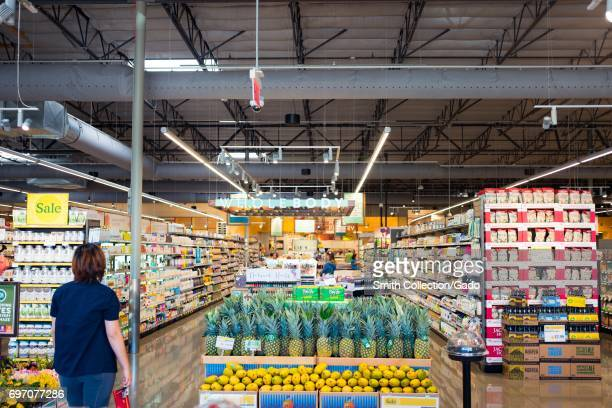Shoppers browse the aisles at Whole Foods Market grocery store in Dublin California June 16 June 16 2017 On June 16 Amazoncom announced that it would...