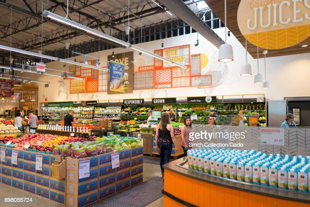 Shoppers browse the produce section at the Whole Foods Market grocery store in Dublin California June 16 2017