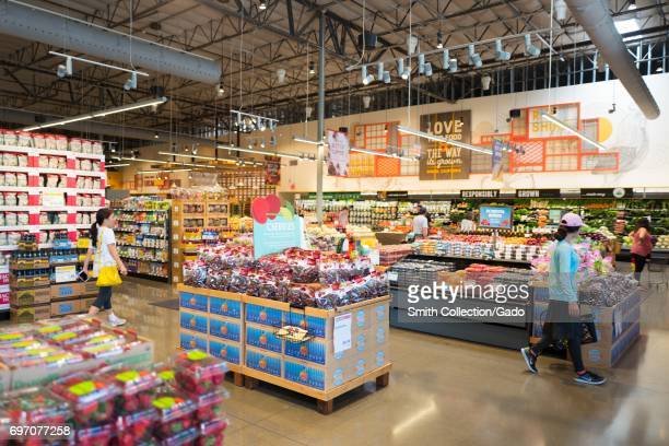 Shoppers browse the produce section at Whole Foods Market grocery store in Dublin California June 16 June 16 2017 On June 16 Amazoncom announced that...