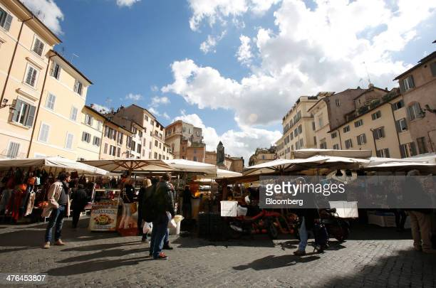 Shoppers browse the stalls at Campo dei Fiori outdoor street market in Rome Italy on Monday March 3 2014 Italian Prime Minister Matteo Renzi is...