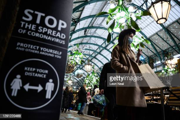 Shoppers browse the stalls in Covent Garden, as talk continues of London entering into 'Tier 3' of the pandemic-control system, on December 14, 2020...
