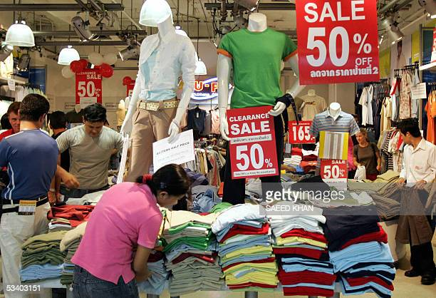 Shoppers browse through a garment shop offering 50 percent discount at shopping mall in central Bangkok 18 August 2005 The central Bank of Thailand's...