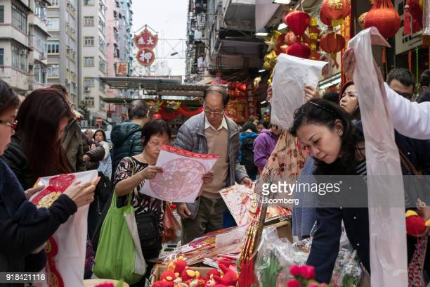 Shoppers browse through decorations at a stall ahead of Lunar New Year in Hong Kong China on Wednesday Feb 14 2018 The city's financial markets will...