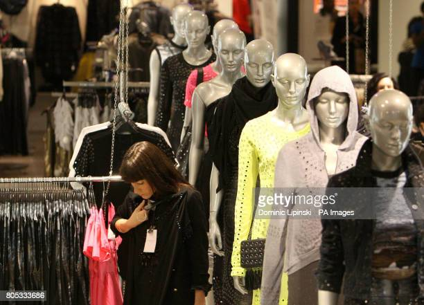 Shoppers browsing the new Christopher Kane for Topshop range in the flagship store on Oxford Street, in central London.