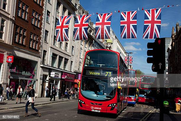 Shoppers buses and Union Jack flags in central London on Oxford Street UK This is the most famous street in the UK for shopping and mid range retail...