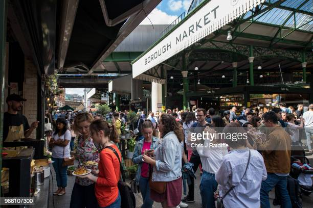 Shoppers buy food at Borough Market on June 2 2018 in London England Borough Market traders gathered at the end of the trading a day ahead of the...