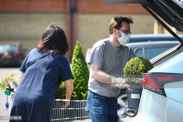 Shoppers buy gardening supplies from a Homebase store in North Finchley on May 09, 2020 in London, England. The UK is continuing with quarantine...