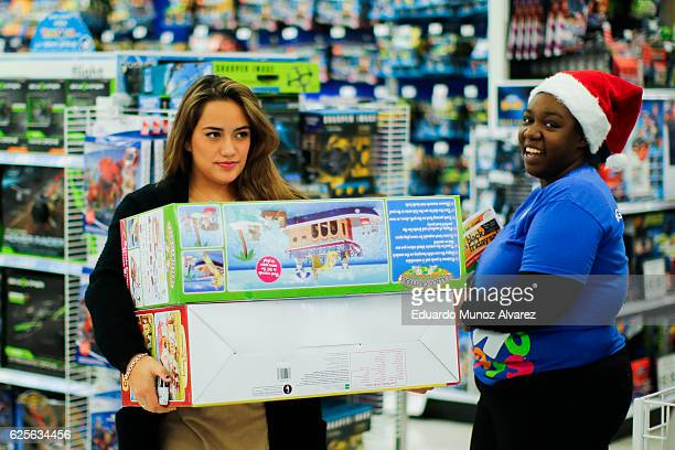 Shoppers buy gifts at the Toys'R'Us store during early Black Friday events on November 24 2016 in Paramus New Jersey Although Black Friday sales are...