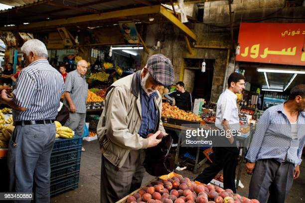 Shoppers buy vegetables at a local market in downtown Amman Jordan on Thursday June 21 2018 President Trump and First Lady Melania Trump will host...