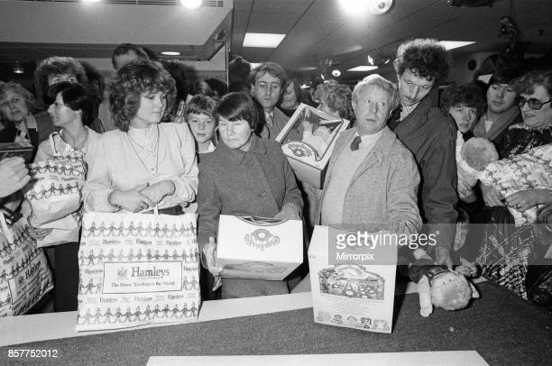 Shoppers buying Cabbage Patch Dolls at Hamleys London toy store 3rd December 1983