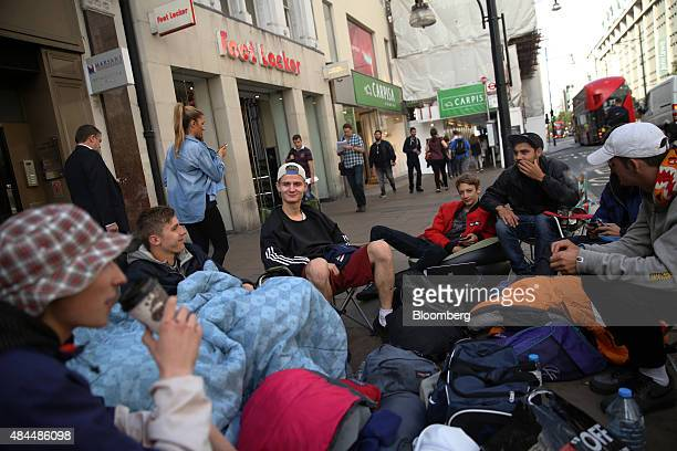 Shoppers camp outside the Foot Locker sports shoe store operated by Foot Locker Inc ahead of the launch of Adidas Ag Yeezy Boost 350 Black a limited...