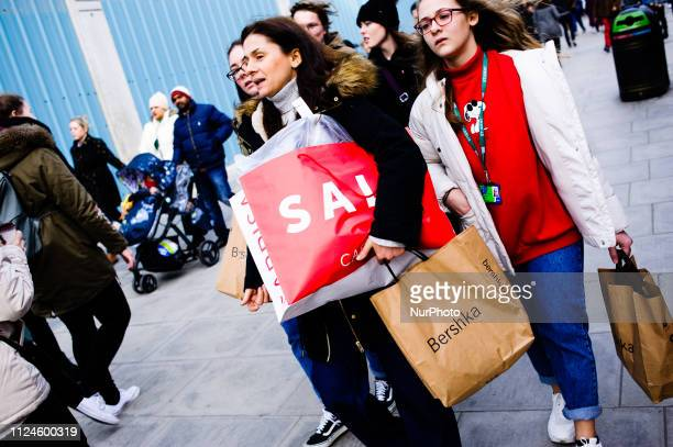 Shoppers carry bags along Oxford Street in London England on February 9 2019 February 15 sees the release of the first monthly retail sales figures...